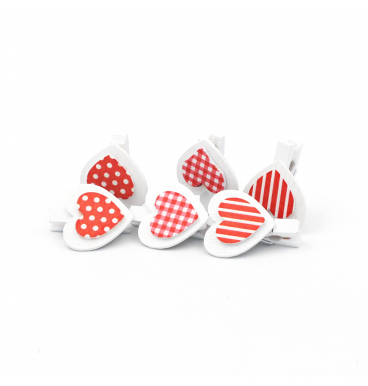 White and red heart pegs with dots