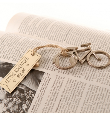 Bicycle bottle opener with tassel