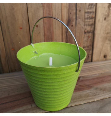 Citronella candle in a green bucket
