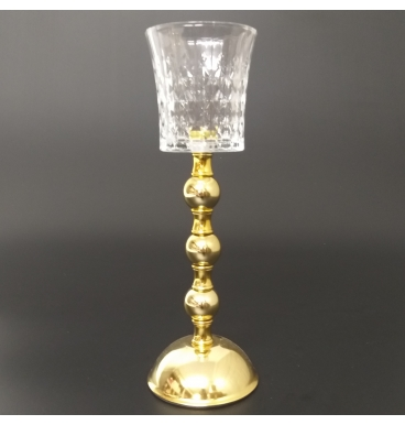 Golden stand with glass candle holder