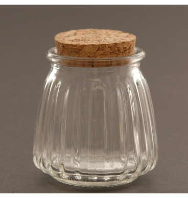 Riffled glass bottle with large cork lid