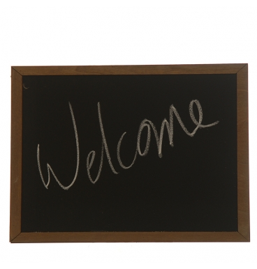 Wooden black board with welcome written on it