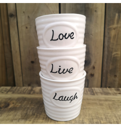 Love live laugh pots stacked in one another